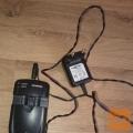 Večnamenski polnilec baterij