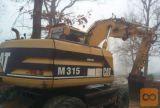 Bager na gumi kolesih Caterpillar M315